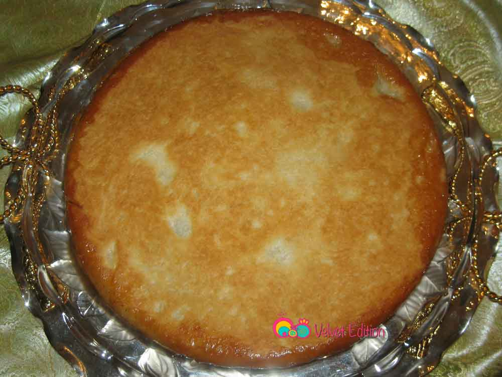 Cover the pie with a larger platter and carefully flip. Wait a few seconds and then remove the pan.