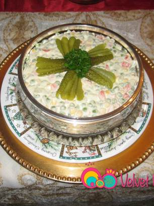 Salad Russe or Salad Olivier with the cooked vegetables and dressing combined.