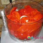Add some of the peppers into the food processor and process till creamy.