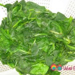 Steam the spinach in salted boiling water, remove and drain in colander.