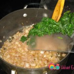 Add the spinach to the onions.