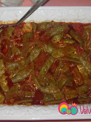 Serve Romano beans in tomato sauce with a side order of rice.