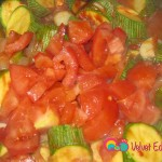 Add the chopped tomatoes. Gently mix everything together.