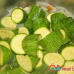 Add the zucchinis to the saucepan and toss for about 5 - 7 minutes.