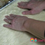 Carefully transfer the dough to the greased baking pan and make sure you cover the edges of the pan.