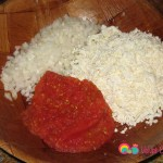 In a bowl combine the pepper paste, tomato paste, grated cheese and diced onions.
