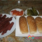 Prepare the sandwich buns, the soujouk, sliced pickles and tomatoes.