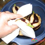 Rinse the eggplants and dry them using a paper towel.