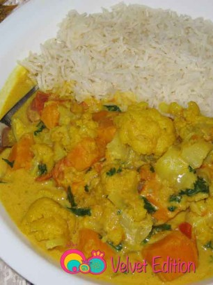 Cauliflower sweet potato coconut curry served with Basmati rice.