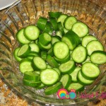 Slice the cucumbers into 1/4 inch slices.